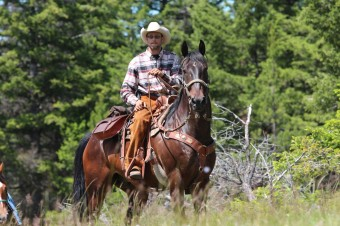 Siwash guides are genuine cowboys and cowgirls.