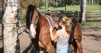 Siwash Lake Luxury Guest Ranch - Saddling up for a luxury horseback riding vacation at BC's #1 wildernes resort and luxury dude ranch