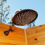 Rain shower head with blue sky above.